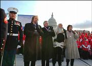 "The Oak Ridge Boys perform the national anthem on the front lawn of the Capitol as they help launch a campaign to teach Americans the lyrics to ""The Star-Spangled Banner."" They were joined Thursday by U.S. Marines who just returned from Iraq, and Washington, D.C., elementary students."