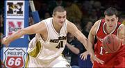 Missouri's Linas Kleiza, left, and Nebraska's Bronsen Schliep try to track down a loose ball. Kleiza scored 26 points, and MU won, 70-67, Thursday in Kansas City, Mo.