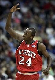 North Carolina State's Julius Hodge celebrates in the second half of his team's game against Wake Forest in the ACC tournament. The Wolfpack stunned the third-ranked Demon Deacons, 81-65, Friday at the MCI Center in Washington.