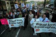 Supporters of gay marriage march down Market Street in San Francisco. San Francisco County Superior Court Judge Richard Kramer overturned California's ban on gay marriage Monday and said that withholding marriage licenses from same-sex couples trespasses on their civil rights.
