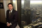 "Joe Nacchio, former Qwest chairman and chief executive officer, and six other executives have been charged by the SEC with orchestrating a ""massive financial fraud"" that hid billions in revenue. Nacchio was pictured in 2001 at his office in downtown Denver."
