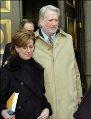 Bernard Ebbers, 63, exits a federal courthouse Tuesday in New York with his wife Kristie. Ebbers, who built WorldCom into a telecommunications titan, was convicted Tuesday of engineering an accounting fraud that would sink the company.