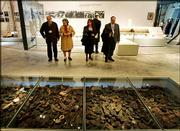 Visitors look at shoes of Jews killed by the Nazis at the Yad Vashem Holocaust Memorial's new museum in Jerusalem. Leaders and dignitaries from some 40 countries attended the opening Tuesday of the museum, which focuses on the personal tragedies of the 6 million Jews who perished in the Holocaust.