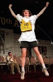 Rebecca Sealfon, 13, of Brooklyn, N.Y., reacts after winning the 70th annual National Spelling Bee in this May 29, 1997, file photo. Spelling bees have grown in popularity in the last few years; ESPN has televised the national competition since 1994.