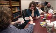 From left, April Russell and Samantha Fabbri, sisters of slaying victim Carmin D. Ross, played cards Wednesday in a conference room at the Judicial & Law Enforcement Center while the jury continued deliberating in the murder trial of Thomas E. Murray. Ross' parents, Judi and Danny Ross, also are pictured.