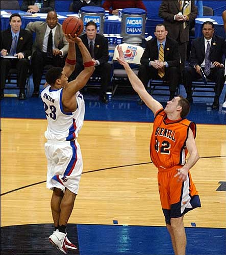 Kansas University's Wayne Simien, left, takes KU's last shot over Bucknell's Chris McNaughton. The shot bounced off the front of the rim, ending the Jayhawks' season with a 64-63 setback Friday to Bucknell in Oklahoma City.