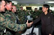 U.S. Secretary of State Condoleezza Rice, right, greets unidentified soldiers at the command control center for South Korea-U.S. Combined Forces at Seongnam, south of Seoul, South Korea. Rice arrived Saturday for a two-day trip to South Korea, the highlight of a recent flurry of diplomacy aimed at bringing North Korea back to the negotiating table over its nuclear weapons program.