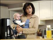"Actress Mercedes Ruehl appears in a scene from the Lifetime movie ""Mom at Sixteen."" Ruehl plays Terry Jeffries, who decides to raise her teenage daughter&squot;s baby as her own son. The drama airs at 8 p.m. Monday."