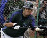 Roberto Alomar bunts during a spring-training game for Tampa Bay. Alomar, seen in this Feb. 25 photo in St. Petersburg, Fla., announced his retirement Saturday.