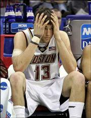 Boston College senior Nate Doornekamp (13) despairs while sitting on the bench late in the Eagles' loss.