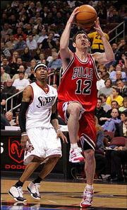 Chicago's Kirk Hinrich, right, drives past Philadelphia's Allen Iverson. Hinrich had 21 points, nine assists and eight rebounds in the Bulls' 94-88 victory Saturday night in Philadelphia.
