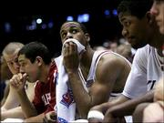 Sooners, from left, Kevin Bookout, Kellen Sampson, Jaison Williams and Johnnie Gilbert watch the final seconds of their 67-58 loss to Utah. OU was ousted from the NCAA's Saturday in Tucson, Ariz.