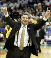 Wisconsin-Milwaukee coach Bruce Pearl signals to the crowd after his team stunned Boston College. After Saturday's 83-75 second-round victory in Cleveland, the No. 12-seeded Panthers are the lowest seed remaining in the NCAA Tournament.