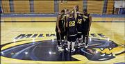 Members of the University of Wisconsin-Milwaukee basketball team huddle at center court during practice. UWM worked out Monday in Milwaukee in preparation for Thursday's game against top-seeded Illinois.