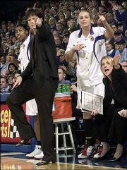 KU coach Bonnie Henrickson, second from left, states her case for an out-of-bounds call as players Alicia Rhymes, left, Jamie Boyd, second from right, and assistant coach Katie O'Connor make their opinions known in this file photo from KU's 63-45 loss to Kansas State on Jan. 8 at Allen Fieldhouse.
