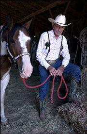 "In 2002, a day before his 81st birthday, Dan Matile posed in his barn with his favorite cutting horse, Digger. Matile, a Flint Hills cowboy since the early 1940s, died in early March. He always wore his pants tucked into the top of his cowboy boots.<br> <a href= ""http://etc.lawrence.com/galleries/DanMatile/8531_lores.html"" target=""_new"" onclick= ""window.open(&squot;http://etc.lawrence.com/galleries/DanMatile/8531_lores.html&squot;,&squot;Photo&squot;,&squot;height=650,width=550,screenX=10,screenY=10,&squot; + &squot;scrollbars,resizable&squot;); return false;""> <img src=""http://www.ljworld.com/art/icons/icon_photo.gif"" border= ""0"" alt=""photo""> Photo Gallery: Cowboy Dan Matile</a><br>"