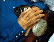 "With his large hands framing his championship belt buckle, Dan Matile lies in his casket with five Jack Daniels playing cards tucked under his palms. The 83-year old longtime Chase County cowboy died earlier this month in Cottonwood Falls and, according to his son Gene, loved to play Pitch.<br> <a href= ""http://etc.lawrence.com/galleries/DanMatile/8531_lores.html"" target=""_new"" onclick= ""window.open(&squot;http://etc.lawrence.com/galleries/DanMatile/8531_lores.html&squot;,&squot;Photo&squot;,&squot;height=650,width=550,screenX=10,screenY=10,&squot; + &squot;scrollbars,resizable&squot;); return false;""> <img src=""http://www.ljworld.com/art/icons/icon_photo.gif"" border= ""0"" alt=""photo""> Photo Gallery: Cowboy Dan Matile</a><br>"