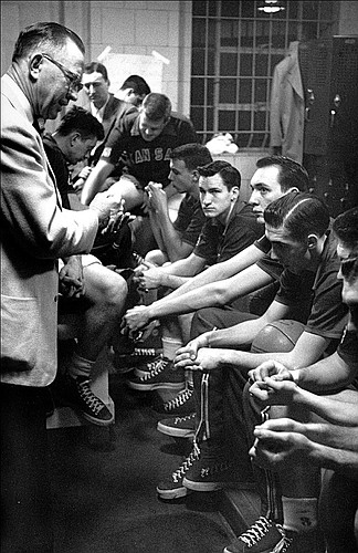 "26 APR 1952:  University of Kansas coach Dr. Forrest ""Phog"" Allen gives his final instructions to his team before playing and winning the NCAA Men's Basketball Final Four held in Seattle, WA at the Edmundson Pavilion. Kansas defeated St. John's 80-63 for the title. future North Carloina coach Dean Smith (facing camera) was a junior at Kansas."