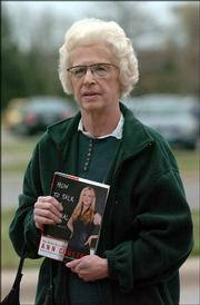 "Kay Wright, Lawrence, carries a copy of Ann Coulter&squot;s book ""How to Talk to a Liberal."" Wright hoped to get it signed for her son, Lt. Col. Kevin Wright, of Fort Knox, Ky."