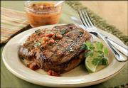 Grilled pork chops with chipotle sauce is a quick and savory dish. The pork chops can be cooked with a gas grill or broiler.