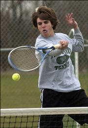 Free State high senior Charles Guard returns a volley during doubles competition against Shawnee Mission South. Guard and his partner, Jack Hull, lost at No. 2 doubles Tuesday at FSHS, but each won their singles matches.