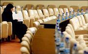 A Parliament member sits alone before the start of Iraq's National Assembly session in Baghdad. Iraq's lawmakers failed to choose a parliament speaker Tuesday during their second-ever session, a long-awaited meeting marred by shouting and finger-pointing.