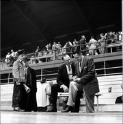 1950's:   Phog Allen, basketball coach at University of Kansas, talking with Bill Mayer, in Lawrence, KS.