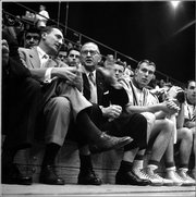 1950's:   Phog Allen, former coach (center, in dark suit) talking with Dick Harp, (left) basketball coach at University of Kansas, in Lawrence, KS.