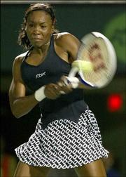 Venus Williams returns a shot from her sister, Venus, in the Nasdaq-100 Open. Venus won, 6-1, 7-6 (8), Tuesday in Key Biscayne, Fla.