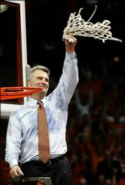 Illinois coach Bruce Weber waves the net after the Illini defeated Arizona in the Chicago Regional championship. Weber celebrated Saturday in Rosemont, Ill.