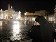 As Pope John Paul II was treated for a high fever late Thursday, a nun prays in St. Peter's Square at the Vatican. The pope suffered heart failure while being treated for a urinary tract infection, and was being treated at the Vatican with antibiotics, the pope's spokesman said. The development came one day after the 84-year-old pontiff began receiving nutrition through a feeding tube.