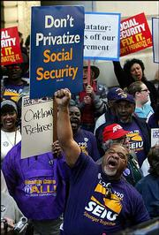 Opponents of President Bush's plan to privatize Social Security protest Thursday outside the Charles Schwab headquarters in San Francisco. Protesters claim that private investment companies like Charles Schwab are conspiring with the U.S. government toward the privatization of Social Security programs. Others say Bush is misleading when he compares it with the retirement savings plan that federal employees have now.