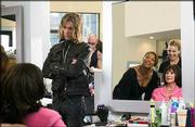 "Jorge (Kevin Bacon) looks on as Gina (Queen Latifah) and Lynn (Alicia Silverstone) finish with a client in the MGM Pictures comedy ""Beauty Shop."" The film opened Wednesday in Lawrence."