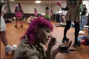 Peggy Noland, aka Estee Slaughter, prepares for competition in the Roller Warriors all-female roller derby league.