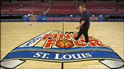 A technician takes light readings in the Edward Jones Dome. Preparations were being made for the Final Four on Thursday in St. Louis. Louisville will play Illinois in the first semifinal Saturday, followed by Michigan State against North Carolina.