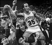 Louisville's Darrell Griffith flashes the No. 1 sign as he's carried by teammates and fans after his team won the 1980 NCAA championship in Indianapolis. This year's Cardinals will face Illinois on Saturday at the Final Four in St. Louis.