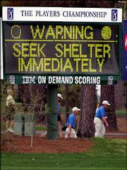 A sign on the course warns of approaching bad weather during the third round of The Players Championship on Sunday. The tournament was hounded by inclement weather all weekend.