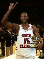 South Carolina's Carlos Powell shows off his trophy after being named the NIT's most valuable player. Powell led South Carolina past Saint Joseph's, 60-57, in the championship game Thursday night in New York.