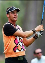 Jesper Parnevik tees off in this file photo from Sunday. Parnevik is one of many golfers setting new fashion trends on the tour with their bright and colorful apparel.