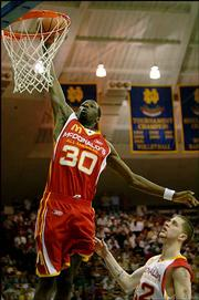 Kansas University signee Julian Wright (30) dunks during the 2005 McDonald's All-American game. Wright scored 14 points and had four assists during Wednesday night's game in South Bend, Ind.