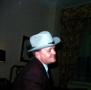 """Author Truman Capote wears a hat given to him by Skipper Williams of Lawrence in this 1966 photo. Capote loved to dress outrageously and adopted a lot of Western wear when he spent time in Kansas doing research for his book  """"In Cold Blood."""""""