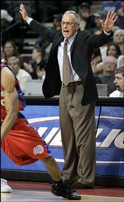 Detroit coach Larry Brown motions from the sideline. Brown returned to the bench Friday night in Auburn Hills, Mich., after a 10-day absence following a procedue related to his hip surgery.