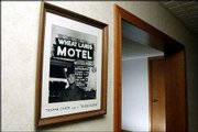 "Truman Capote&squot;s portrait hangs in the lobby of the Wheat Lands motel in Garden City, Kan. The motel was his home base in Garden City, Kan., while he conducted interviews for ""In Cold Blood.""<br> <a onclick= ""window.open(&squot;http://www2.ljworld.com/photos/galleries/2005/apr/03/in_cold_blood_a_legacy_in_photos/166/&squot;, &squot;PhotoGallery&squot;, &squot;width=650,height=650,scrollbars=yes,resizable=yes&squot;); return false;"" href= ""http://www2.ljworld.com/photos/galleries/2005/apr/03/in_cold_blood_a_legacy_in_photos/166/""> <img src=""http://www.ljworld.com/art/icons/icon_photo.gif"" border= ""0"" alt=""text""> See slide show »</a>"