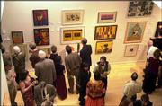 The annual lawrence art auction will be Saturday at the Lawrence Arts Center, 940 N.H. Doors open at 6 p.m., and the live auction begins at 7:30 p.m. Above, patrons browse artwork at the 2003 Lawrence Art Auction.