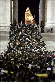 Thousands of people fill St. Peter's Square to enter St. Peter's Basilica at the Vatican and pay their respects to late Pope John Paul II on Monday.