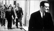 Killers Richard Hickock, foreground, and Perry Smith, in suit, walk through the federal courthouse in Topeka in this 1963 photo taken by Bill Snead of the Journal-World, who was then a photographer for the Topeka Capital-Journal.