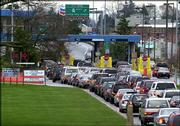 Vehicles line up to enter the United States from Canada at the Peach Arch border crossing in Blaine, Wash., on Feb. 16, 2004. Tourism officials in Washington state are concerned that new rules requiring Americans to have passports to re-enter the United States from Canada will be bad for business.