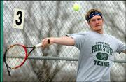 Free State High's No. 1 singles player, Keith Pipkin, returns a serve. Pipkin went 2-1 during a quadrangular Wednesday at FSHS.