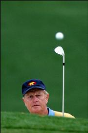 Jack Nicklaus watches his shot to the seventh green during the first round of the 2005 Masters. Nicklaus, in what might be his final Masters, was 4 over par after 12 holes when play was suspended because of darkness Thursday at the Augusta National Golf Club in Augusta, Ga.