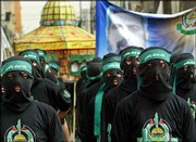Masked Hamas militants rally in a refugee camp in the northern Gaza Strip. Hamas warned Friday that they will stop observing a truce with Israel if a planned march to the Temple Mount in Jerusalem by Israeli opponents to the Gaza withdrawal plan takes place Sunday.